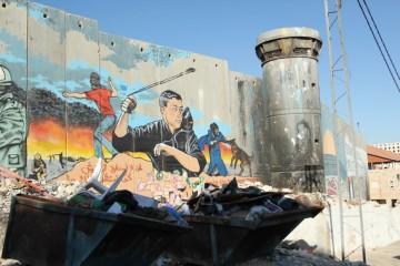 Bryan MacCormack_graffiticoverswallinguardtowerinaidarefugeecamp